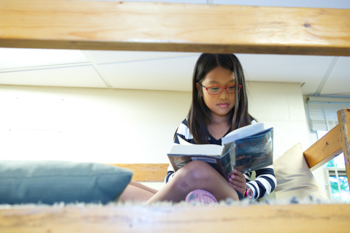 A student reading a book during a Language Arts class