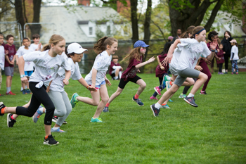 A group of students running during a physical education class